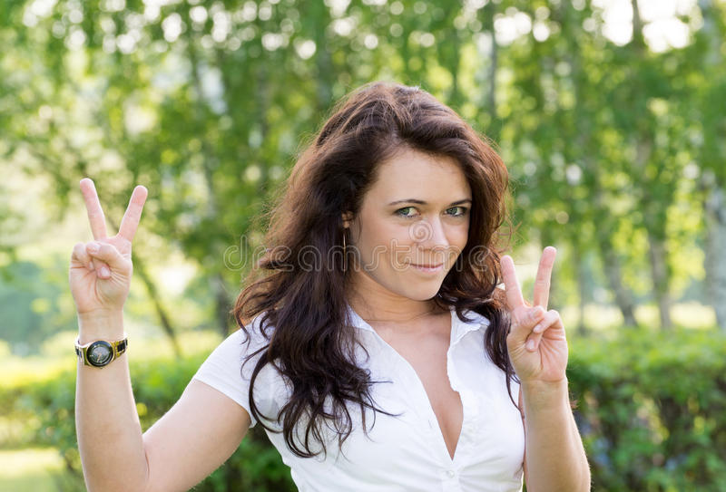 Beautiful girl on nature shows a sign that everything is fine stock image