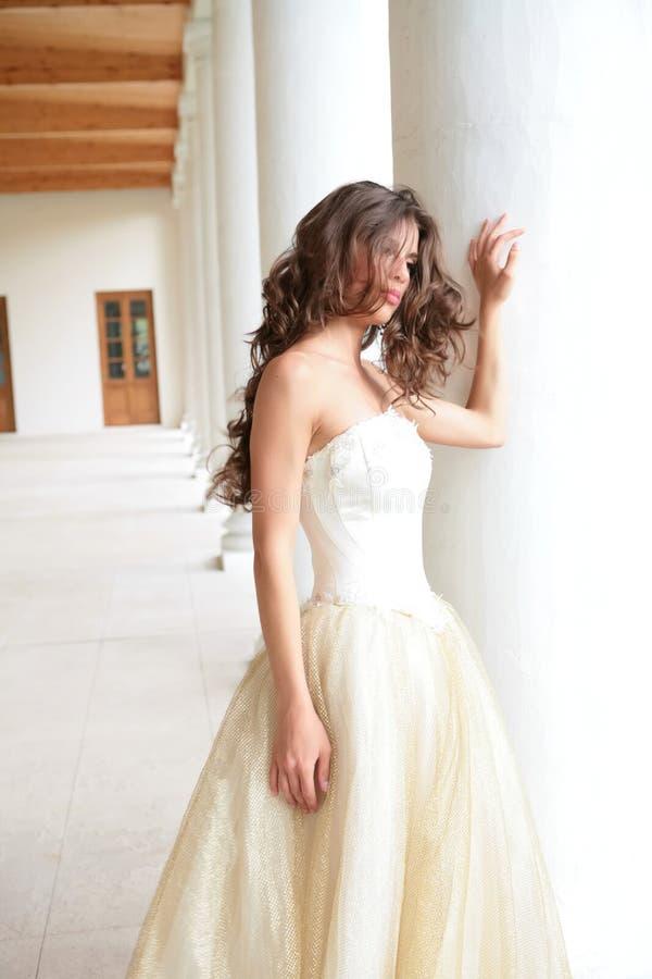 Beautiful Girl Near Pillars Royalty Free Stock Photography