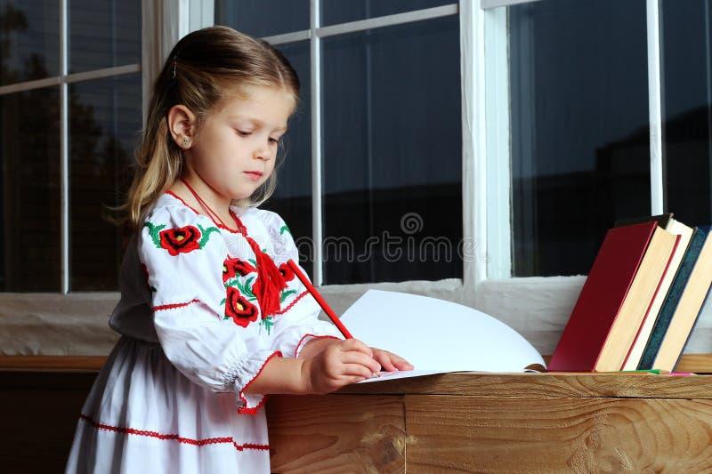 Beautiful girl near the window stock photography