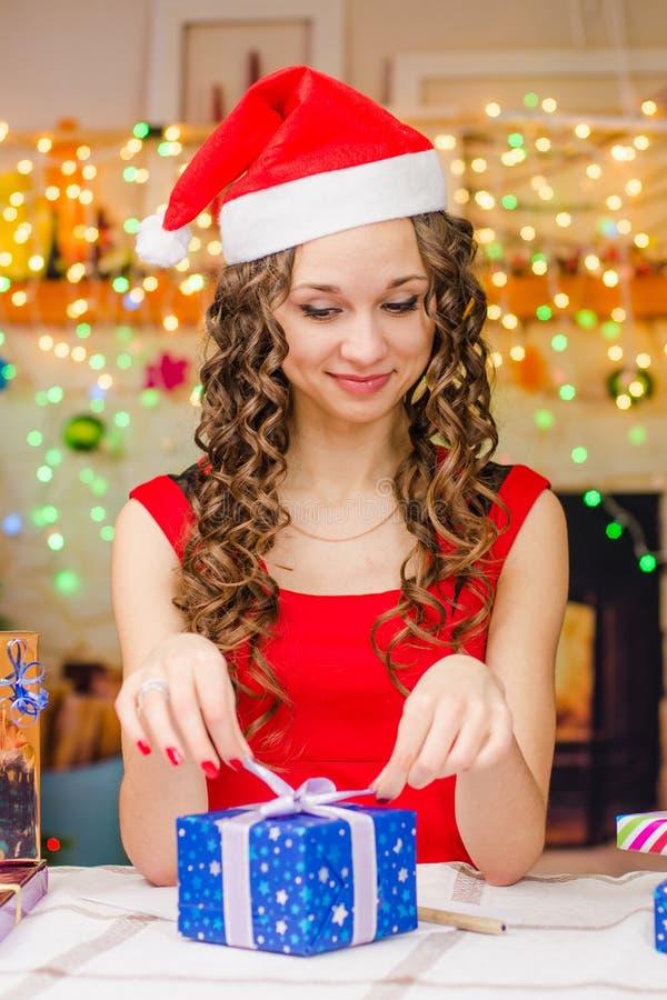 Beautiful girl New Year's gift packs royalty free stock photos