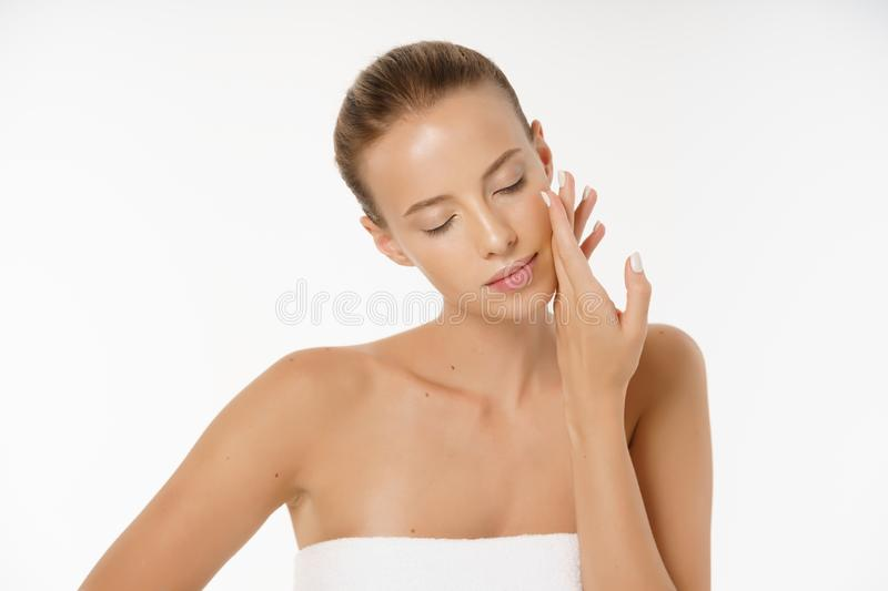 Beautiful girl with nude make up posing at grey studio background, beauty photo concept, perfect skin. stock photography