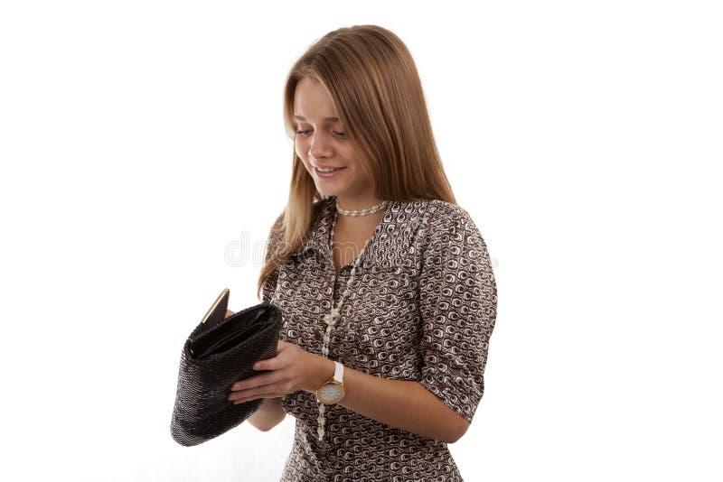 Beautiful girl opens her handbag royalty free stock photo