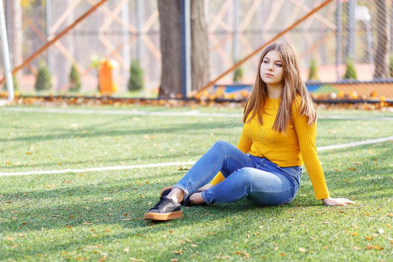 Beautiful girl at outdoor in autumn time. Portrait, garden royalty free stock photo