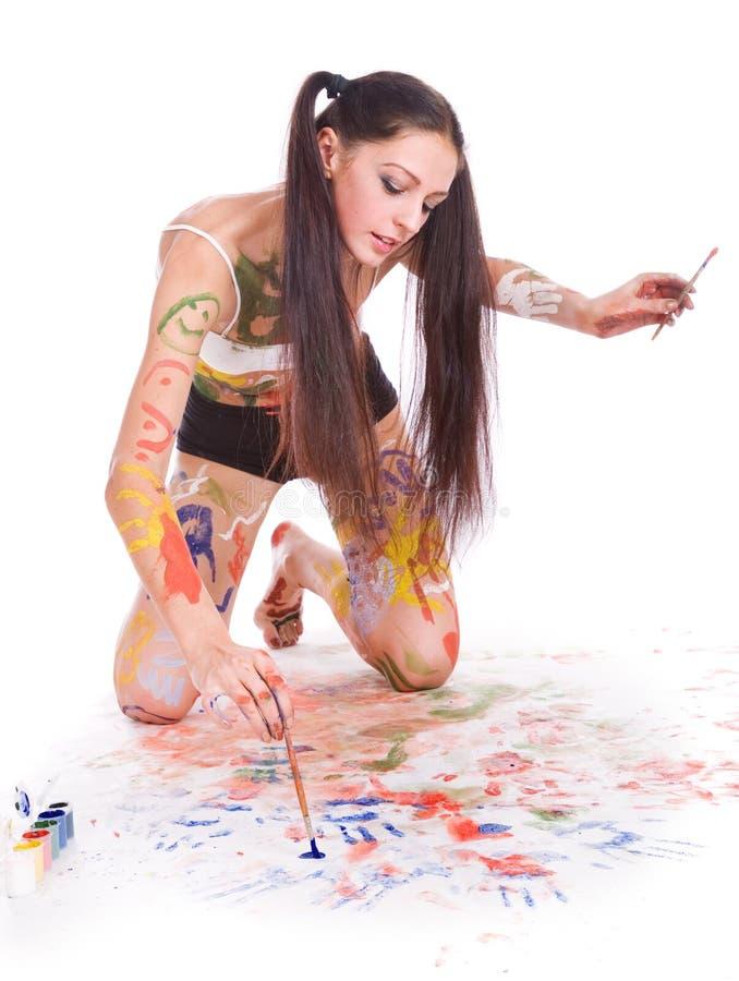 Beautiful girl paints stock photography