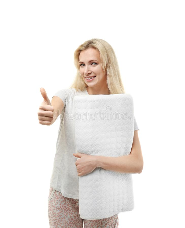 Beautiful girl in pajama with orthopedic pillow, isolated. On white stock photo