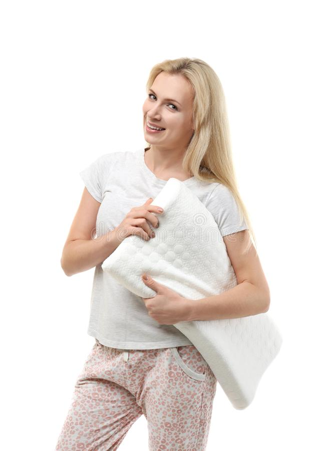 Beautiful girl in pajama with orthopedic pillow, isolated. On white stock photography