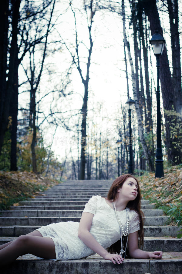 Download Beautiful girl in park stock photo. Image of trees, dark - 27403032