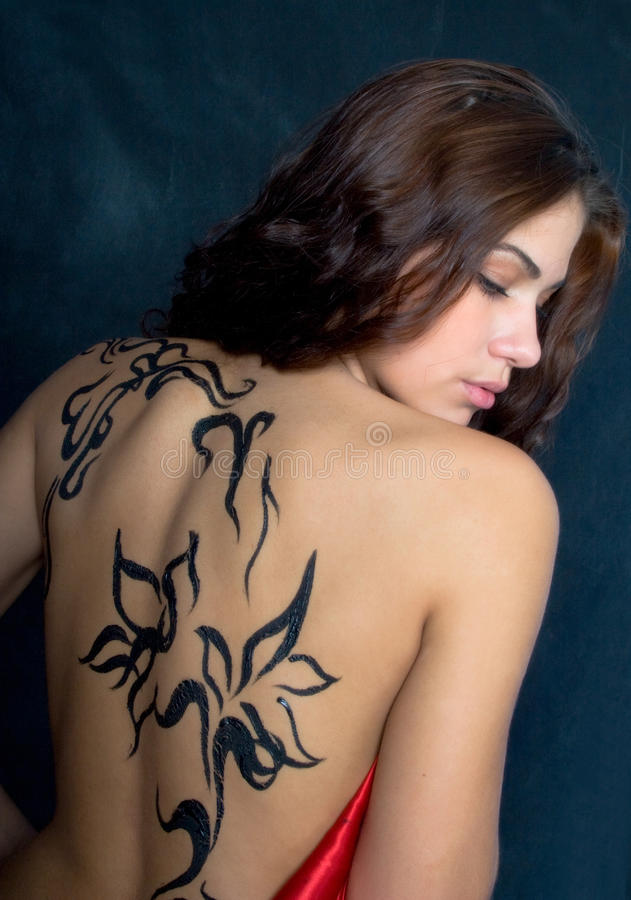 A beautiful girl with a pattern on its back royalty free stock images