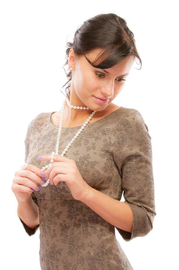 Download Beautiful Girl With Pearl Beads Looks Downwards Stock Image - Image: 13644793