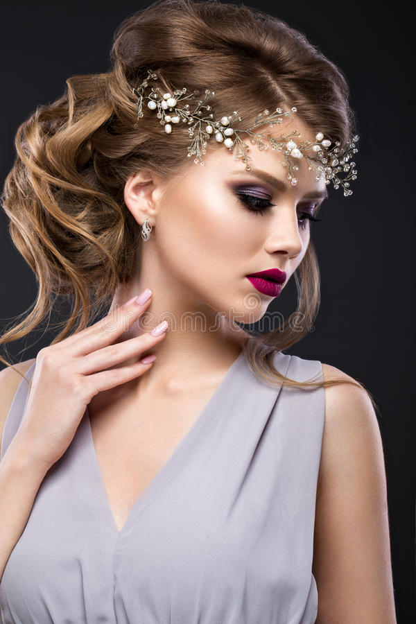 Beautiful girl with perfect skin, evening make-up, wedding hairstyle and accessories. Beauty face. Beautiful girl with perfect skin, evening make-up, wedding royalty free stock photography