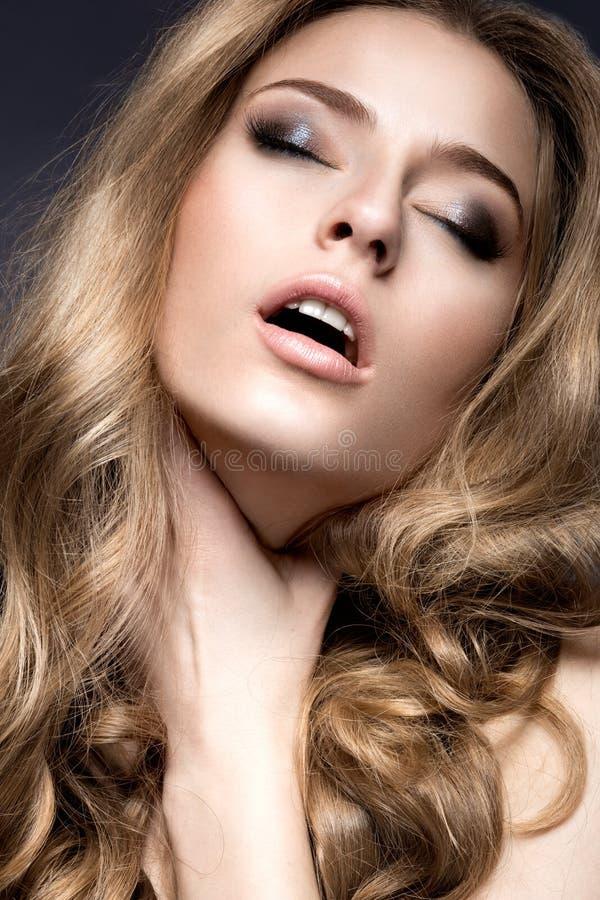 Beautiful girl with perfect skin and evening makeup. stock image