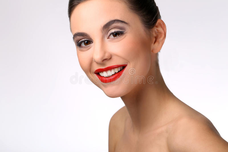 Beautiful girl with perfect skin and red lipstick royalty free stock photography
