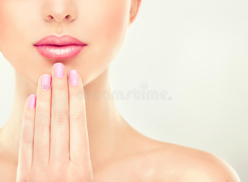 Beautiful Girl with pink manicure stock image