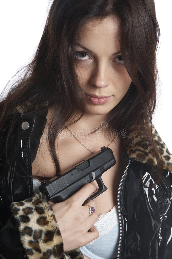 The beautiful girl with a pistol. On a white background stock photo