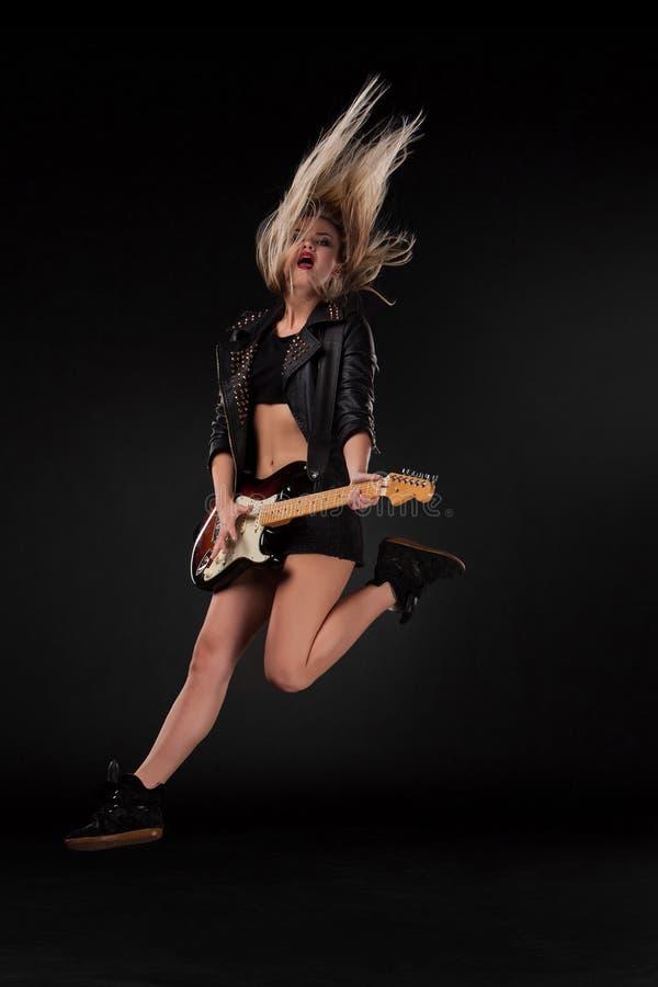 Beautiful girl playing guitar royalty free stock images