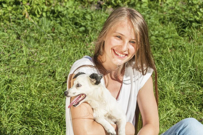 Beautiful girl playing with dog royalty free stock photography