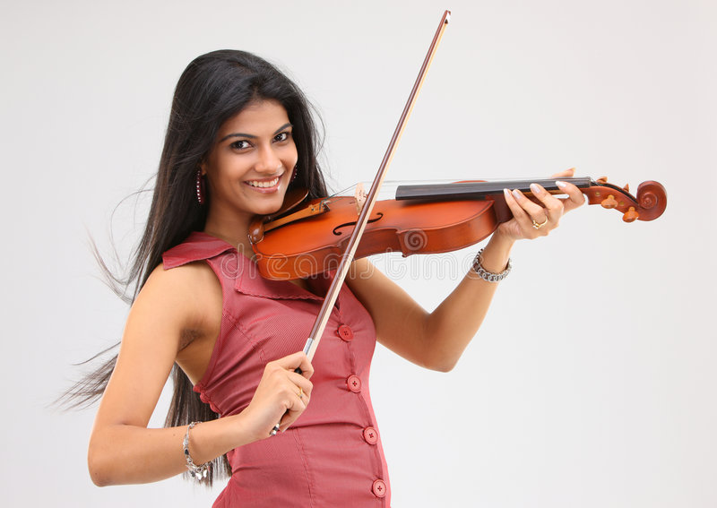 Beautiful girl playing violin royalty free stock image