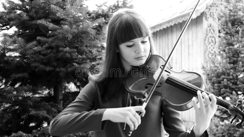 Beautiful girl playing violin  Childhood, sound