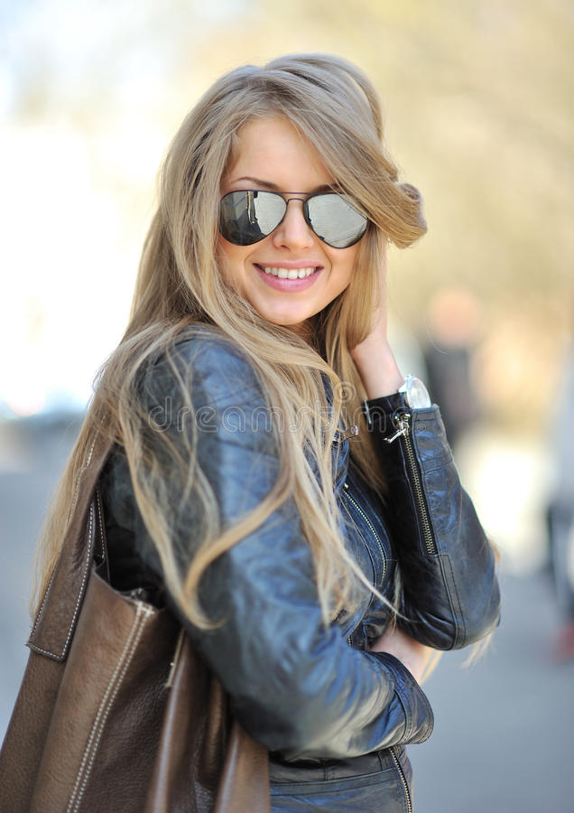 Beautiful girl portrait. In sunglasses royalty free stock photography