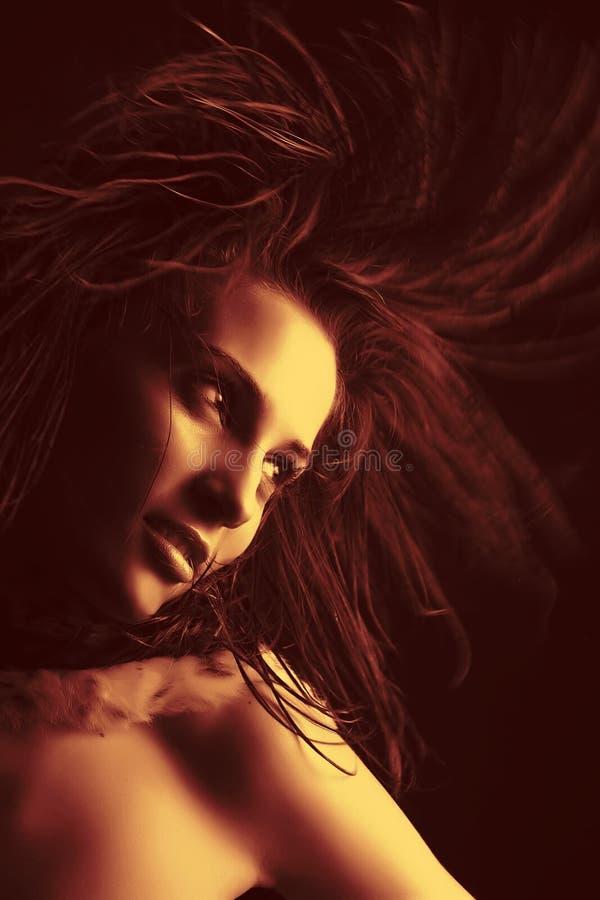 Beautiful girl portrait. Fashion shot of beautiful girl in motion royalty free stock image