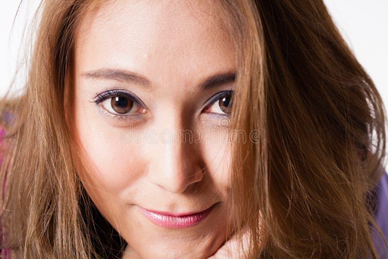 Beautiful girl. Portrait of beautiful Asian woman pose showing nice hair royalty free stock image