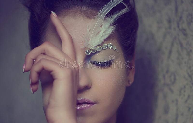 Beautiful girl portrait. Close-up with an extravagant make-up stock photos