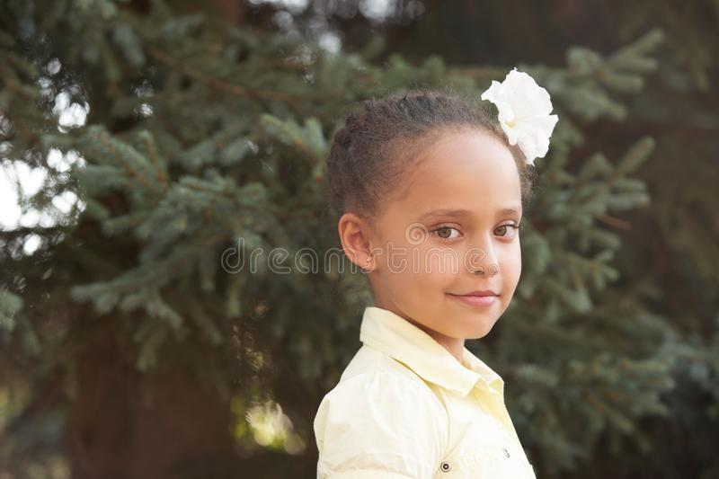 Beautiful girl. Portrait cute baby. Background nature. Sunny day.  stock photo