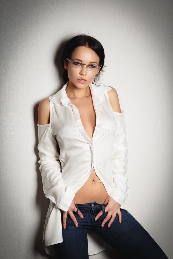 Beautiful girl portrait in a dark pants. Beautiful young girl portrait in a dark pants stock photo