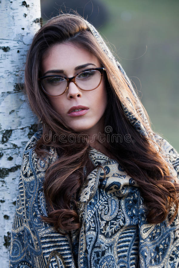 Beautiful girl portrait with eyeglasses outdoor. Young beautiful girl portrait with eyeglasses and scarf outdoor closeup royalty free stock photos