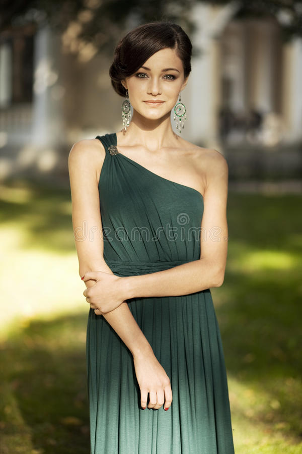 Beautiful girl portrait. With a green dress in the park after prom royalty free stock image