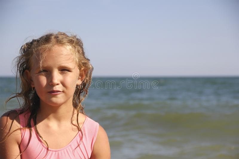Beautiful girl portrait happy. Beautiful girl portrait smiling happy against the sea stock images