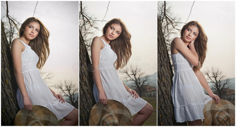 Beautiful Girl Portrait With Hat Near A Tree In The Garden. Young Caucasian Sensual Woman In A Romantic Scenery. Girt In White Stock Image