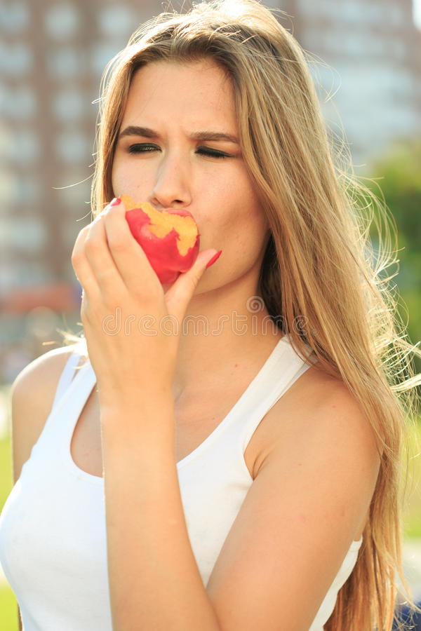 Beautiful girl portrait holding apple. eating fruit. Closeup beautiful girl portrait holding apple. eating fruit royalty free stock photography