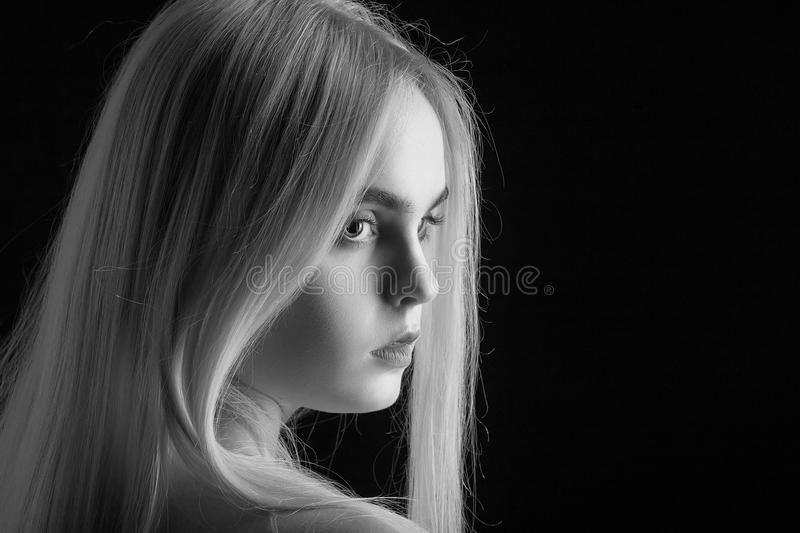 Beautiful girl portrait. With long blond hair, monochrome stock photography