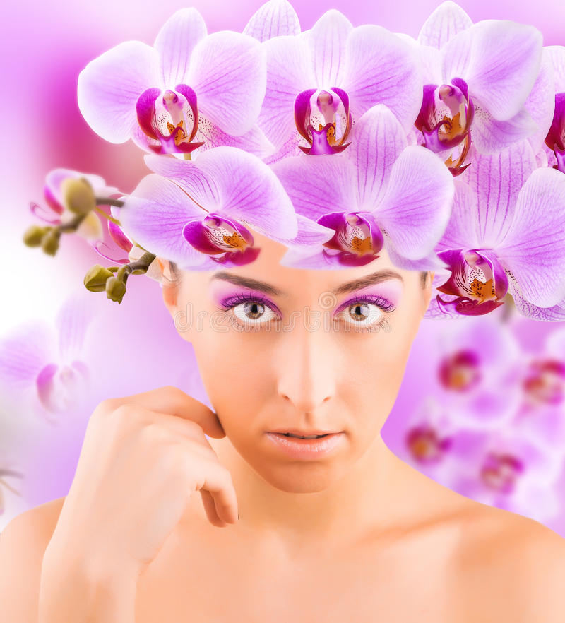 Beautiful girl portrait with orchids. This image has attached release stock image