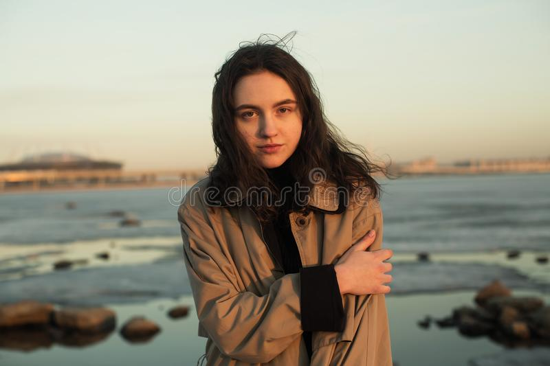 Beautiful girl portrait. Photo shoot near river. Beautiful girl portrait. Photo shoot near river at winter stock image