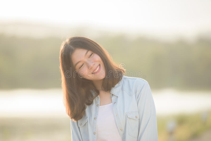 Beautiful girl portrait. During sunset smiley happy with nature background stock photos
