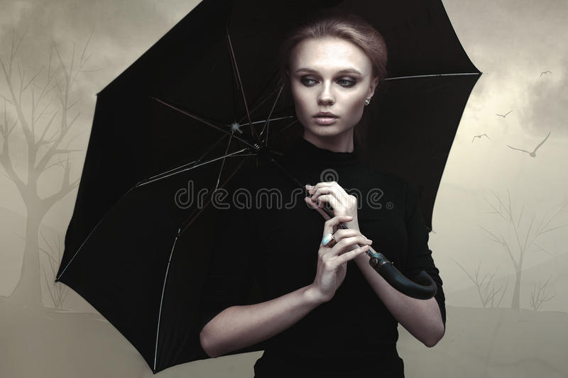 Beautiful girl portrait with umbrella. Outdoor royalty free stock image
