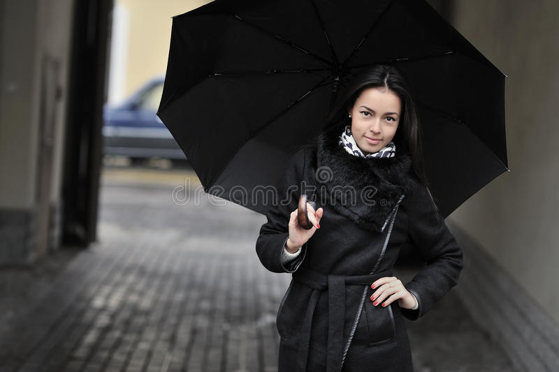 Beautiful girl portrait with umbrella. Outdoors royalty free stock image