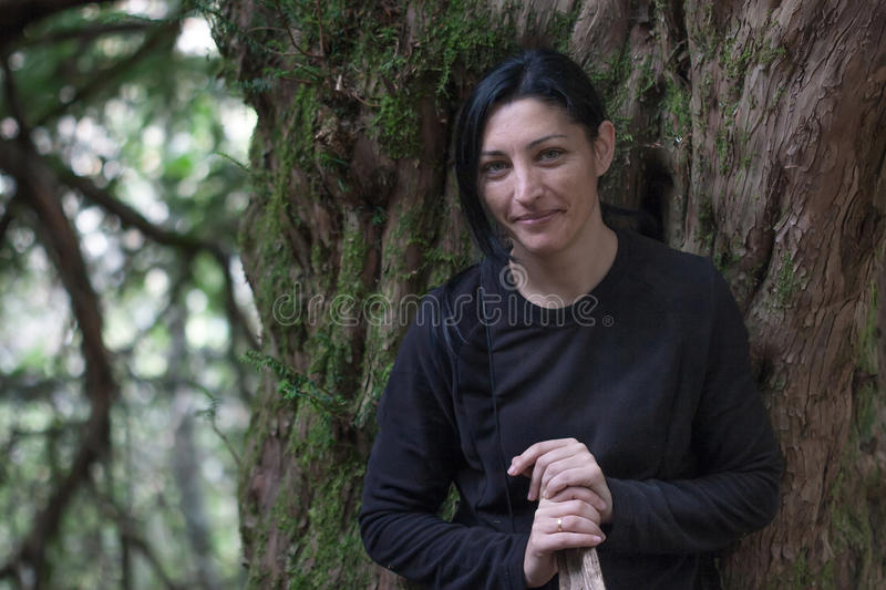 Beautiful girl portrait on yew forest. stock photo