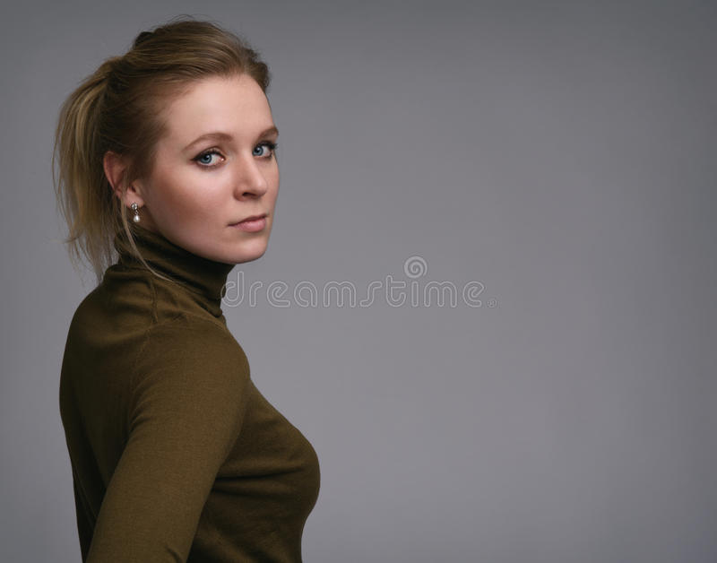 Beautiful girl portrait. Young Woman looking at camera royalty free stock image