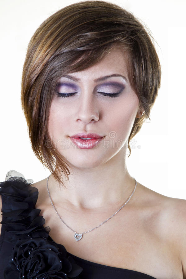 A Beautiful Girl Poses With Purple Makeup Stock Image