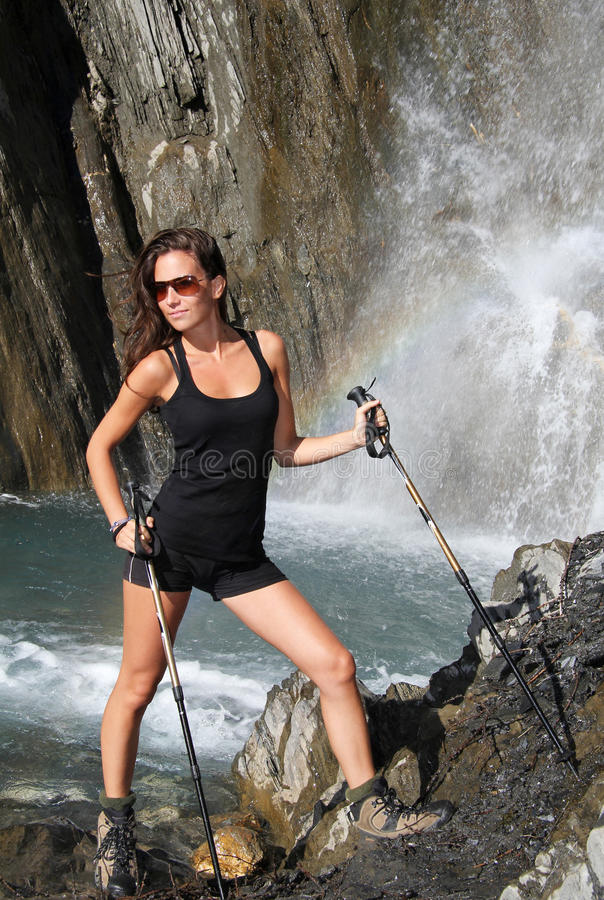 Download Beautiful Girl Poses Under Mountain Waterfall Stock Image - Image of adventure, stream: 26480057