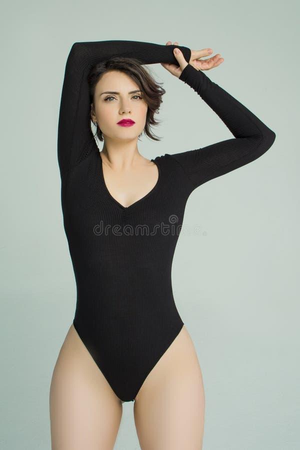 Beautiful girl posing in bodysuits lingerie. In the Studio stock photos