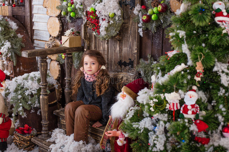 Beautiful girl posing in Christmas decorations stock photography