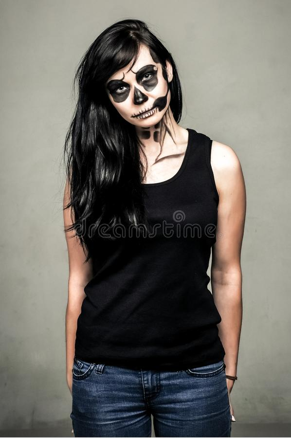 Beautiful girl posing in halloween style. Isolated studio portrait stock images