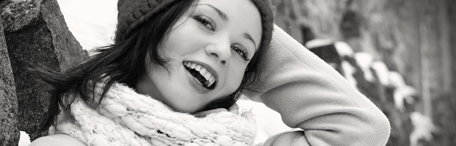 Beautiful girl posing. Smiling outdoors in winter, monochrome banner royalty free stock photos