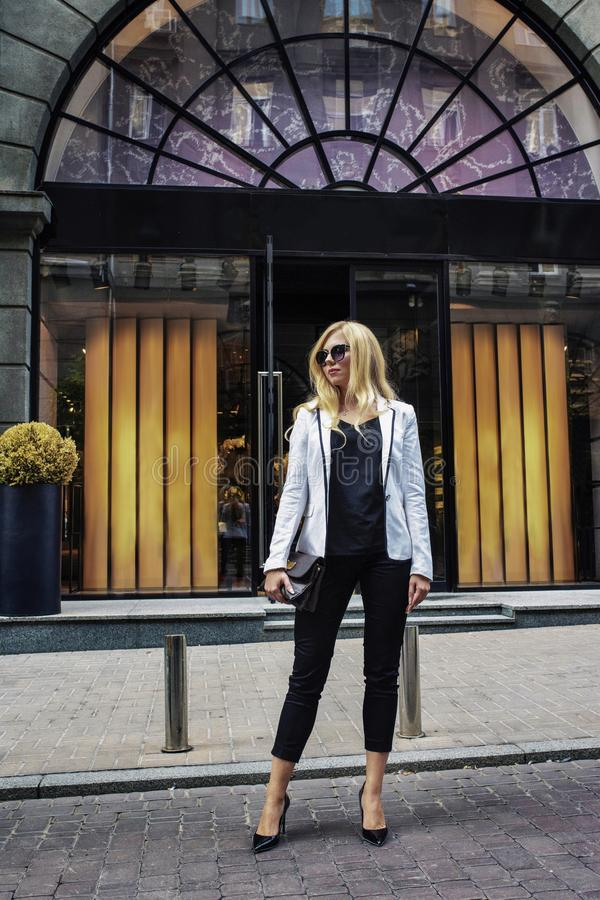 Beautiful girl posing on street. Model walking in street of european city. Female fashion. Concept - Fashion, beauty royalty free stock image