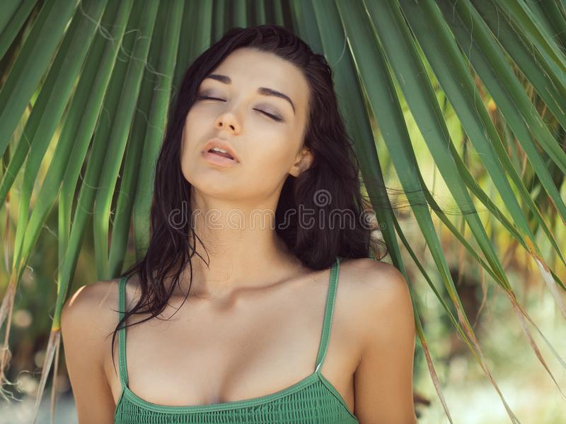 Beautiful girl posing in tropical forest. Close-up perfect portrait royalty free stock photo