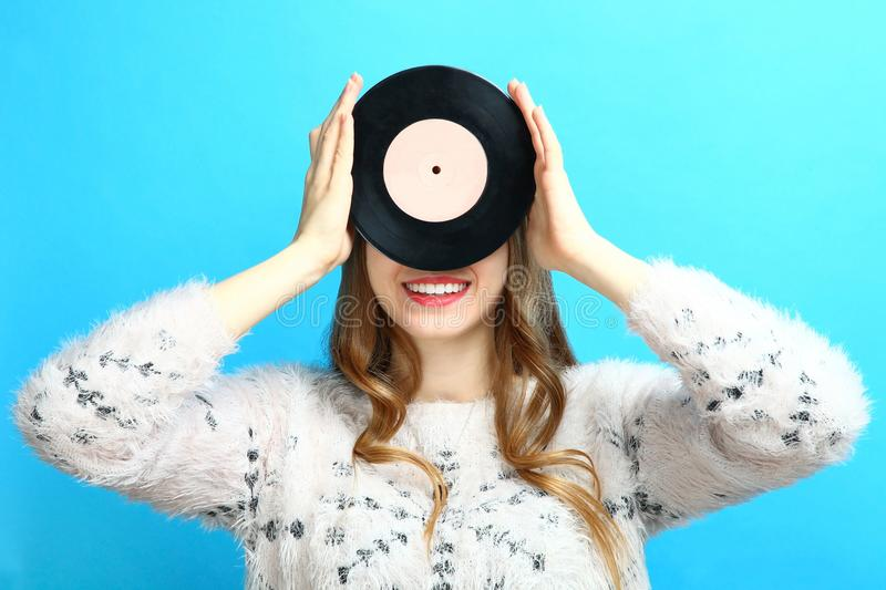 Girl with a vinyl record royalty free stock photography